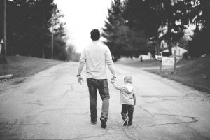 Father and young son walking together