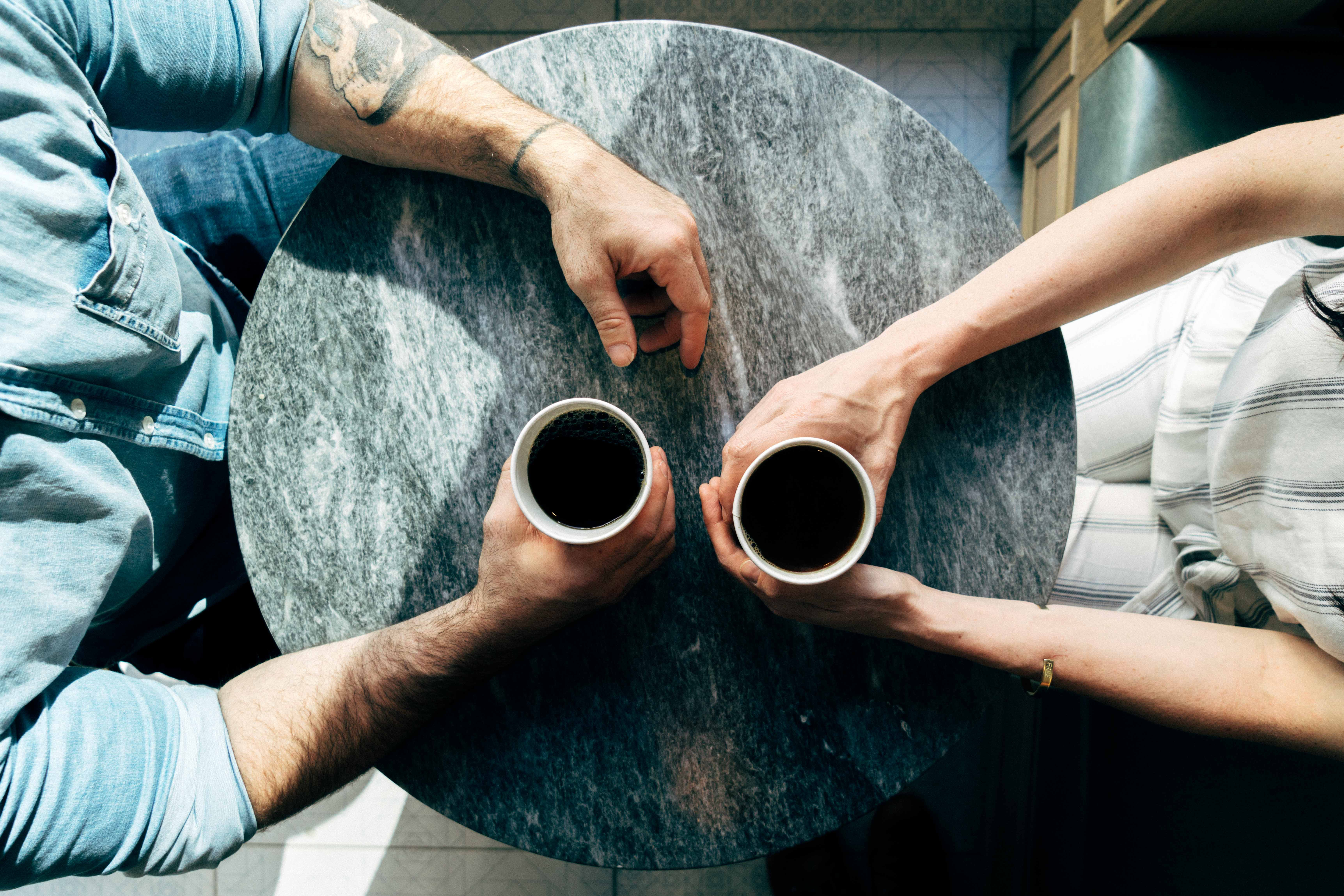 Two people talking over coffee